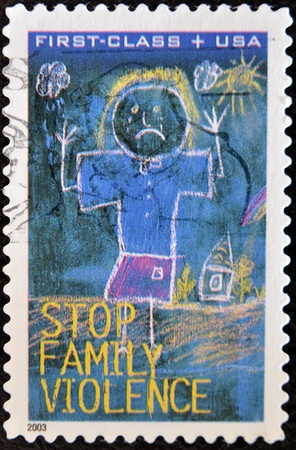 perforated stamp: UNITED STATES OF AMERICA - 2003: A stamp printed in the United States of America shows image concerning to end of Family Violence, series, 2003