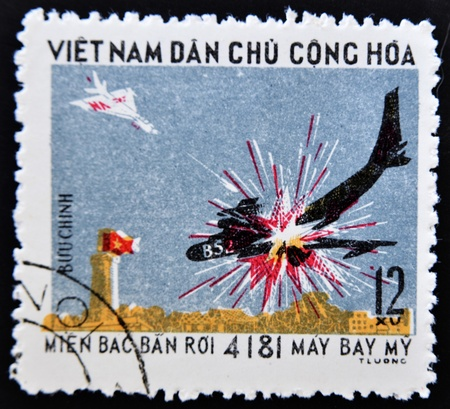 philately: VIETNAM - CIRCA 1970: A stamp printed in Vietnam shows breaking down a fighter plane to another, circa 1970