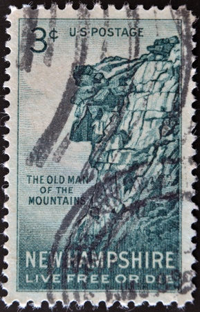 UNITED STATES OF AMERICA - CIRCA 1955: stamp printed in USA, shows Great Stone Face, New Hampshire, live free or die, circa 1955.  photo