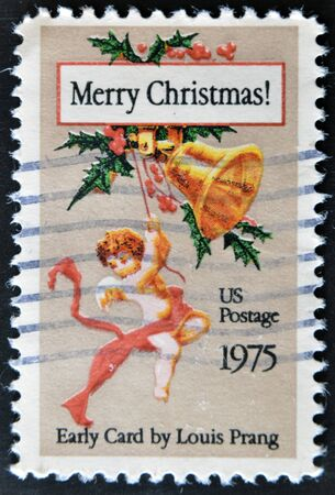 UNITED STATES OF AMERICA - CIRCA 1975: A stamp printed in USA shows Christmas Angel on Early card by Louis Prnag, circa 1975 Stock Photo - 11438943
