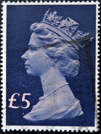 UNITED KINGDOM - CIRCA 1970: An English One Pound Used Postage Stamp showing Portrait of Queen Elizabeth 2nd, circa 1970  Stock Photo - 11438968
