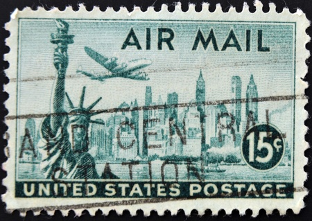 UNITED STATES OF AMERICA - CIRCA 1941: A stamp printed in the USA showing New York and Statue of Liberty, circa 1941  photo