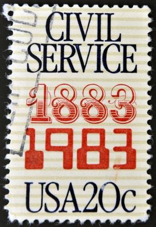 public sector: UNITED STATES OF AMERICA - CIRCA 1983: A stamp printed in the USA commemorates the 100th anniversary of the Civil Service, circa 1983
