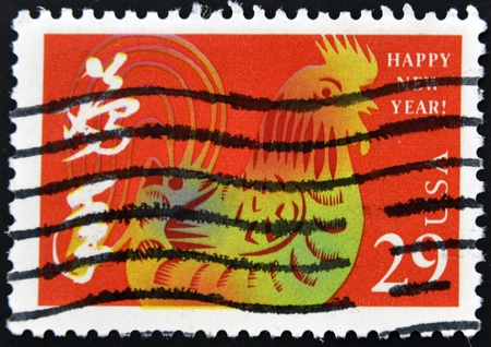 UNITED STATES - CIRCA 1992 : stamp printed in USA, shows year of the rooster, circa 1992  photo