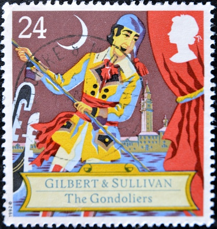 gilbert: GREAT BRITAIN - CIRCA 1992: a stamp printed in the Great Britain shows Scene from comic opera, the gondoliers by Gilbert and Sullivan, circa 1992 Editorial