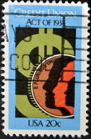credit union: UNITED STATES - CIRCA 1984: a stamp printed in USA depicting money sign and people, inscription Credit Union Act of 1934 , value 20c, circa 1984  Stock Photo