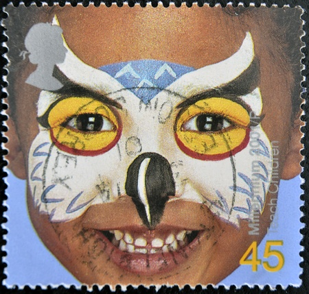 UNITED KINGDOM - CIRCA 2001: A stamp printed in England, is dedicated to painted faces of children, circa 2001 Stock Photo - 11439035
