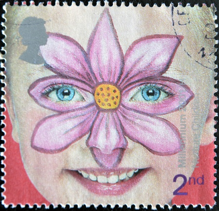 UNITED KINGDOM -CIRCA 2001: A stamp printed in England, is dedicated to painted faces of children, flower, circa 2001 Stock Photo - 11439037