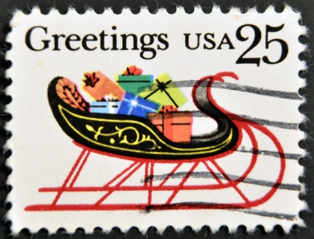 UNITED STATES OF AMERICA - CIRCA 1989: stamp printed in USA, shows sleigh full of presents, circa 1989 photo