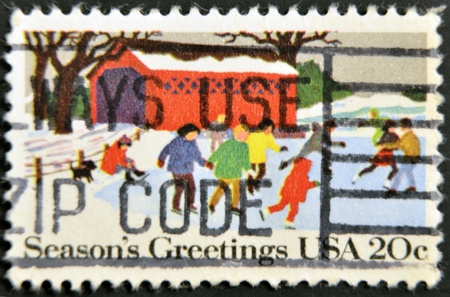 UNITED STATES - CIRCA 1980 : A stamp printed in United States shows Kids Skating Christmas Issue, circa 1980 Stock Photo - 11439044