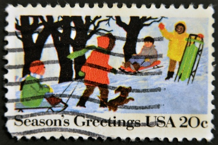 UNITED STATES OF AMERICA - CIRCA 1975 : A stamp printed in the USA shows Season?s Greetings, circa 1975  photo