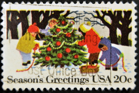 UNITED STATES - CIRCA 1982: stamp printed by Umited States, shows Children Decorating Christmas Tree, circa 1982  photo