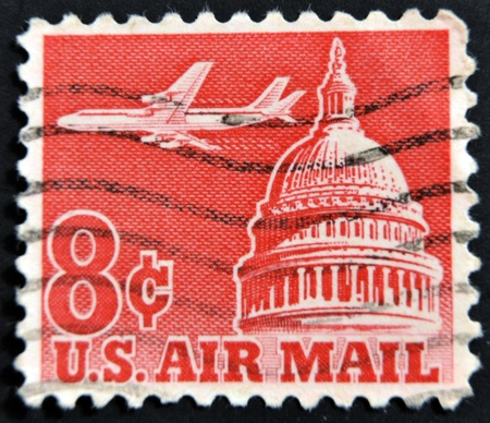 UNITED STATES OF AMERICA - CIRCA 1970: A stamp printed in the USA shows airplane and capitol, circa 1970 photo