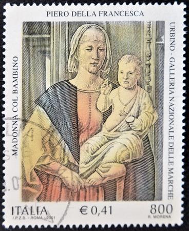 ITALY - CIRCA 2001: A stamp printed in Italy shows the Virgin and Child by Piero della Francesca, circa 2001 Stock Photo - 11439096