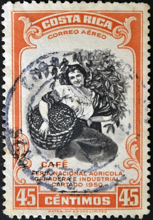 dedicated: COSTA RICA - CIRCA 1950: A stamp printed in Costa Rica dedicated to agricultural fair, livestock and industrial Carthage, shows a woman picking coffee, circa 1950