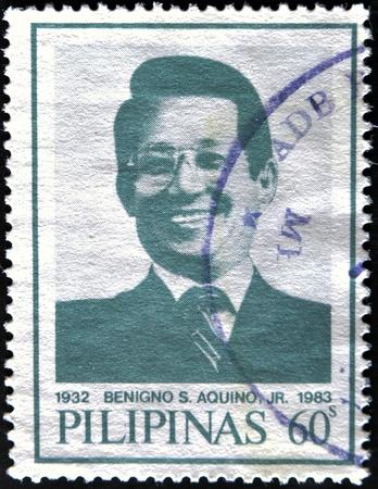 corazon: PHILIPPINES - CIRCA 1986: A stamp printed in Philippines shows Benigno Aquino, husband of Corazon Aquino, circa 1986