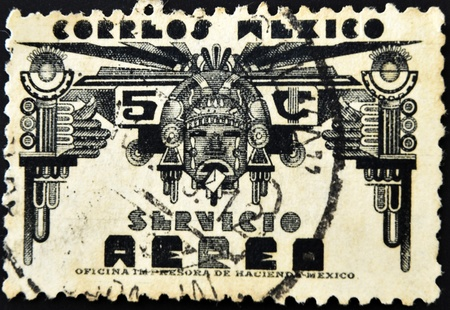 MEXICO - CIRCA 1950: A stamp printed in Mexico shows Columbian face as a symbol of a post office, circa 1950 photo