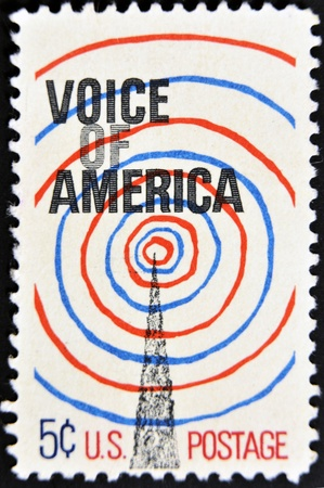 UNITED STATES OF AMERICA - CIRCA 1967: A stamp printed by USA shows a radio tower and Voice Of America, circa 1967.  photo
