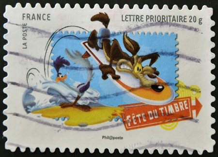 FRANCE - CIRCA 2009: A stamp printed in France shows Wile E. Coyote and the Road Runner, Looney Tunes, circa 2009 Stock Photo - 11452717