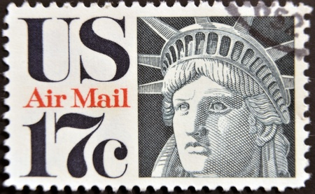 UNITED STATES OF AMERICA - CIRCA 1941: A stamp printed in the USA showing the face of the Statue of Liberty, circa 1941 photo