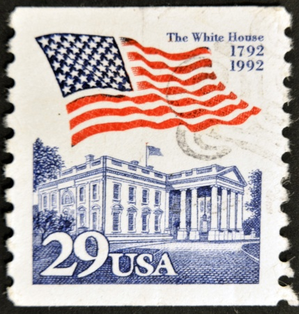 postal office: UNITED STATES OF AMERICA - CIRCA 2001: stamp printed in USA, shows flag and the white house, circa 2001