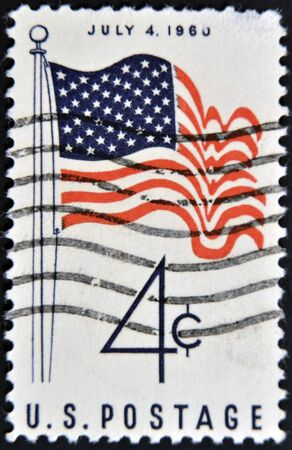 USA - CIRCA 1960: A stamp printed by USA shows the USA Flag, july 4, circa 1960.  Stock Photo - 11439113
