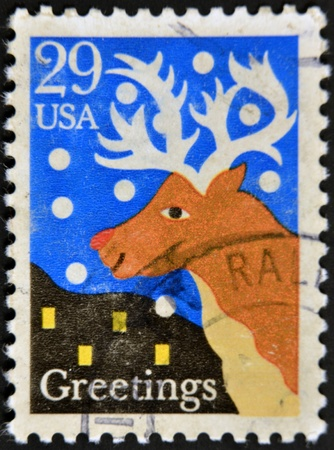 perforated stamp: UNITED STATES OF AMERICA - CIRCA 1990: A stamp printed in USA shows Santas reindeer, greetings, circa 1990