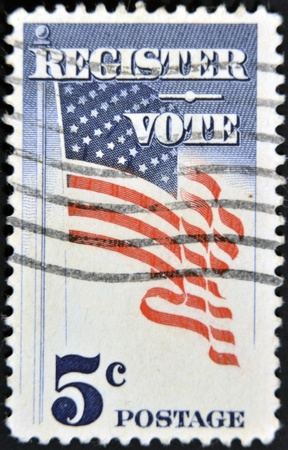 USA - CIRCA 1964 : A stamp printed in the USA shows Register Vote and american flag, circa 1964 Stock Photo - 11439118