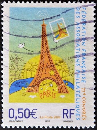 FRANCE - CIRCA 2004: A stamp printed in France shows a funny drawing of the Eiffel Tower, circa 2004 Stock Photo - 11439135
