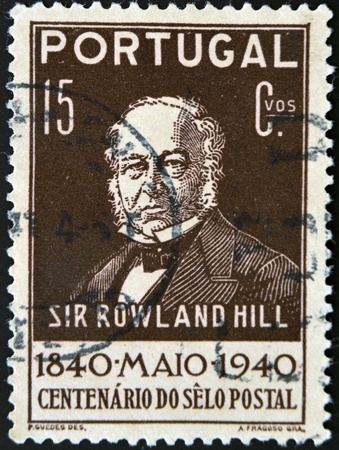 PORTUGAL - CIRCA 1940: A stamp printed in Portugal shows Sir Rowland Hill, circa 1940 Stock Photo - 11439145