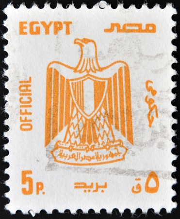 EGYPT - CIRCA 1990: A stamp printed in Egypt shows Egypt's official shield, circa 1990 Stock Photo - 11439159