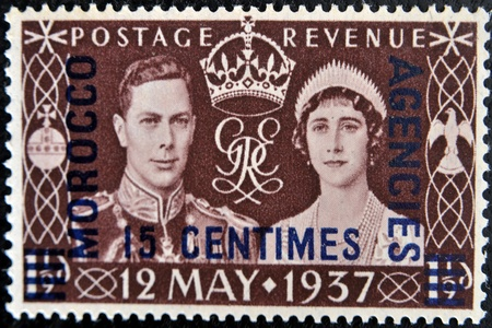 UNITED KINGDOM - CIRCA 1937: A stamp printed in Great Britain showing an image of the coronation of George VI with queen Elizabeth, circa 1937.  Stock Photo - 11439199