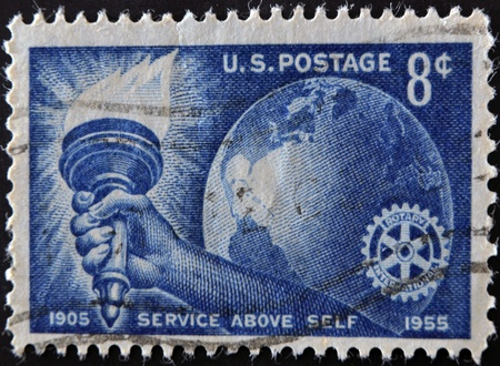 UNITED STATES OF AMERICA - CIRCA 1955: Stamp printed in USA, shows Torch Globe and Rotary Emblem, circa 1955  Stock Photo - 11439173