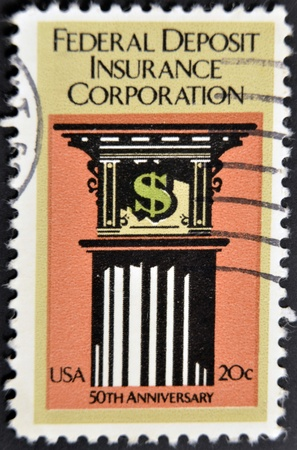 UNITED STATES - CIRCA 1984: A stamp printed in USA shows image commemorating the 50th anniversary of the Federal Deposit Insurance Corporation, circa 1984   photo