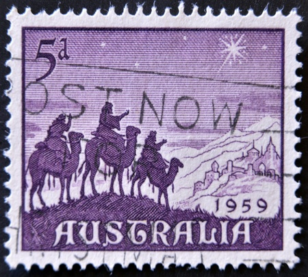 AUSTRALIA - CIRCA 1959: a stamp celebrates Christmas showing the Magi carried by camels, going to worship the Christ. Australia, circa 1959  photo