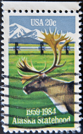 UNITED STATES - CIRCA 1983: stamp printed in USA, shows Caribou and Alaska pipeline, circa 1983  photo