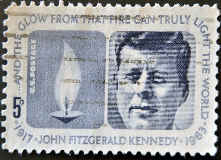 john fitzgerald kennedy: USA-CIRCA 1970:A stamp printed in USA shows image portrait John Fitzgerald  Kennedy was the 35th President of the United States, circa 1970. Editorial