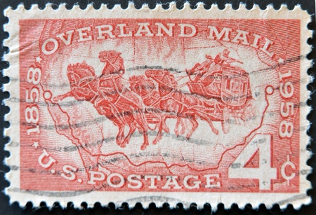 UNITED STATES OF AMERICA - CIRCA 1958: A stamp printed in USA celebrating 100 years of overland mail circa 1958  Stock Photo