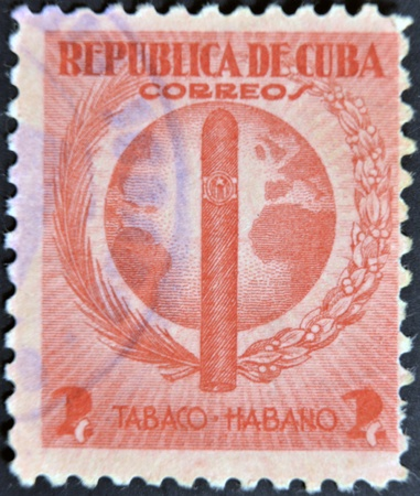 CUBA - CIRCA 1940: A stamp printed in Cuba dedicated to Havana snuff, circa 1940 photo