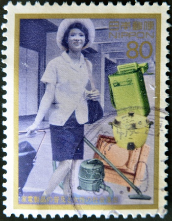 diffusion: JAPAN - CIRCA 1996: A stamp printed in Japan dedicated to Diffusion of home appliances and women, circa 1996 Stock Photo