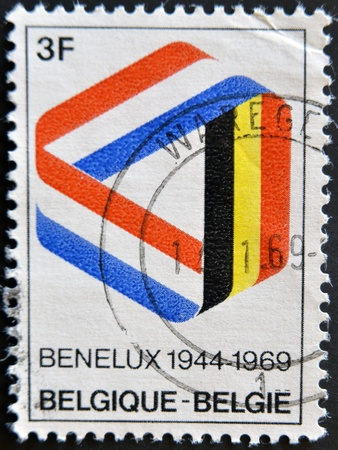 BELGIUM - CIRCA 1969: Postage stamp published in Belgium commemorating 25 years of the Benelux, economic union of Belgium, Netherlands, Luxembourg, circa 1969  photo
