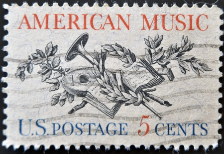 UNITED STATES OF AMERICA - CIRCA 1964: A stamp printed in USA, shows Lute, Horn, Laurel, Oak and Music Score, circa 1964  Stock Photo