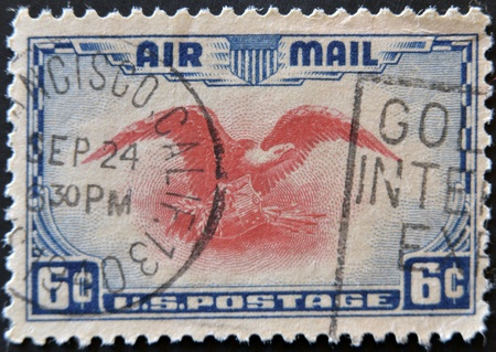 UNITED STATES OF AMERICA - CIRCA 1938: a stamp printed in USA shows Eagle holding shield, olive branch and arrows, circa 1938 photo