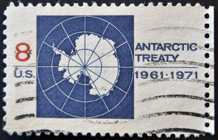 united states postal service: UNITED STATES OF AMERICA - 1971: A stamp printed in the United States of America shows image celebrating the Antarctic Treaty, series, 1971  Stock Photo