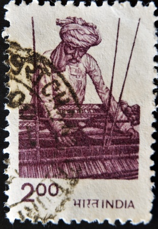 INDIA - CIRCA 1980: A stamp printed in India, shows employee braiding of wicker chair, circa 1980  photo