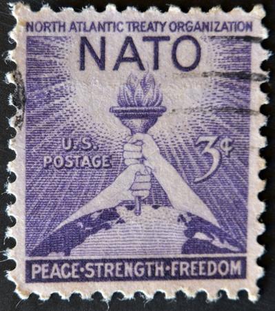 north atlantic treaty organization: USA - CIRCA 1952 : A stamp printed in the USA shows North Atlantic Treaty Organization (NATO), Peace, Strenght, Freedom, circa 1952