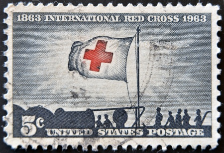 Stock Photo:   UNITED STATES - CIRCA 1943: stamp printed by United states, shows Flag of Red Cross, circa 1943
