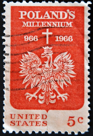 USA - CIRCA 1966: A Stamp printed in USA shows the Polish Eagle and Cross, devoted to 1000th anniv. of the adoption of Christianity in Poland, circa 1966  photo
