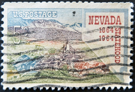 statehood: USA - CIRCA 1964: A stamp printed in the USA shows Nevada statehood, 1864-1964, circa 1964