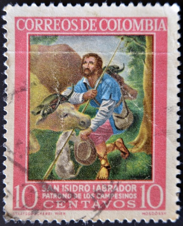 COLOMBIA - CIRCA 1960: A stamp printed in Colombia shows San Isidro Labrador, patron of farmers, circa 1960